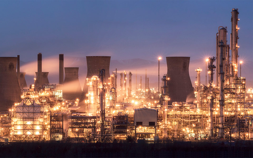 chemical plant lit up after dark